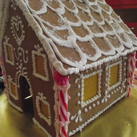 Gingerbread House Less Is More  I designed 4 types of gingerbread houses, candle holders, and purses this year and this house was by request. The client aid she wanted a...