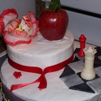 "Twilight Saga Cake 10"" Rounds with 1 6"" round - covered in buttercream, MMF Chess Pieces and Marble board, sating ribbon, artifical tulip, and a..."