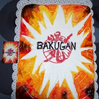 Bakugan Cake   This is a sheet cake, decorated in buttercream and tinted pipeing gel, for my son's 6th Birthday - thank you for looking