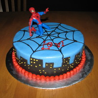 Spiderman Cake Chocolate cake with buttercream frosting, fondant accent, and a spiderman toy for the top. Thanks CC decorators for the help, and the ideas...