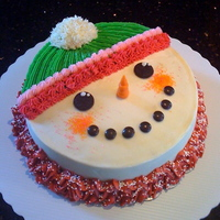 Frosty The Snowman Wearing His Turtleneck My version of the popular Frosty the Snowman cake. He's wearing a turtleneck and a thick, woolen cap. Cinnamon chocolate gluten-free...