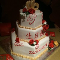 Chinese Cake Red and White and gold cake for a sweet 16 birthday ,cake was a vanilla ,chocolate and red velvet cake.