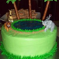 Jungle Birthday  A birthday cake for a friend's son. Copied from a Wilton pic. Palm trees are royal icing and pretzels. Lake is piping gel. Check out...