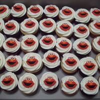 Elmo Cupcakes for a first birthday....chocolate and white with vanilla buttercream...with a coordinating smash cake