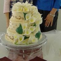 Me_And_Diann.jpg THis a white cake with buttercreme icing. Fondant Calla Lillies.