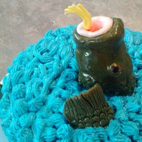 "Fathers Day Fish Cake Father's Day cake for husband. Buttercream ""water"". Fish and lure is fondant. TFL"