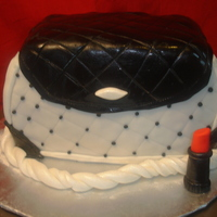 "Black & White Purse My 2nd purse cake. Still learning as I go :) Chocolate cake with whipped chocolate ganache filling. Covered in fondant. ""Lipstick&quot..."