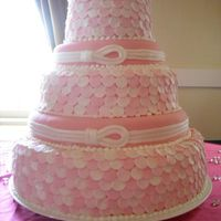 Fondant Polka Dot Wedding Cake This is my first completely covered fondant cake I've done. The double layers were strawberry/white cake swirl, and the single layers...