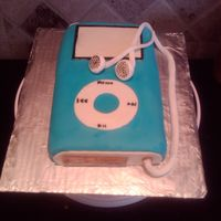 Ipod Cake This is the 4th cake I have made. I am really pleased with it. It is chocolate cake with cream cheese icing and MMF. It is the first time I...