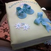 Quick Baby Shower Baby Book I needed to quickly put together a cake for a baby shower cake in a few hours for a friend. This was a quick baby shower book. Ideally I...