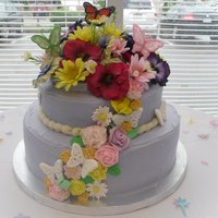 Butterfly And Flowers Bridal Shower Cake  The bottom layer is chocolate cake with raspberry mousse filling and the top was a yellow cake with almond custard filling. It is iced in...