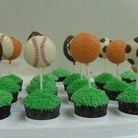 Sports Cupcakes   I made these cupcakes for my son's birthday. I used the grass tip for the cupcakes and made candy lollipops.