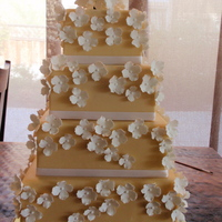 Hydrangea Cake 6,8,10 and 12 inch square cake. Color should be ivory but it turned out more of a peach color. 6 and 8 are lighter than the 10 and 12. I...