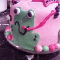 Frog Childrens Birthday Cake Frog birthday cake with tiara on top and lots of little bugs.