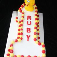 Big Bird & Elmo First Birthday  This is all made from sugar modelling paste, I did big birds in the modelling paste and then covered it with little circles of yellow royal...