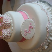 White Bootie Christening Cake  This is daughters Christening Cake. I moulded the booties from sugar modelling paste and then stuck all the flowers on them (which were...