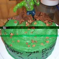 Hulk Cake Terrible photo, sorry! All done in buttercream icing. Hulk is an action figure. This was such a fun cake and my son loved it!