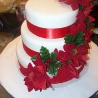 Christmas Wedding fondant covered, silk flowers. first wedding cake.