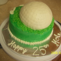 Golf Ball half sports ball on top of 8in round. green coconut for the grass and fondant tees.