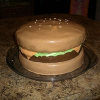 Hamburger Cake This is one of my earlier cakes (about my 6th). I made this for hamburger night at a church gathering. It is white cake with buttercream...