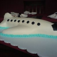 Airplane Cake I made this cake as a welcome home gift for my wife. It is carved out of a sheet cake. It is white cake with buttercream and marshmallow...