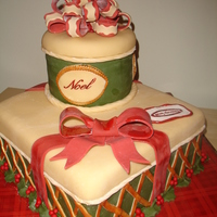 Stacked Christmas Gifts! 12 inch square (choc. with chocolate-mint butter cream) and 6 inch round (vanilla cake with orange cranberry mousse) stacked and decorated...