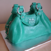 Coach Purse Cake! My first attempt at a purse cake. For a friend's girlfriend's birthday to match her own Coach purse!