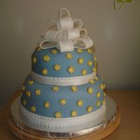 Nov_2008_120.jpg My first stacked cake. It was for my son's preschool teacher and her favorite color is blue. The yellow flowers help the cake look...