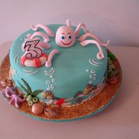 Under Water Cake This cake was for my son's birthday. The octopus is made with 50/50 gp + fondant. When I made the front right arm I wrapped the arm...