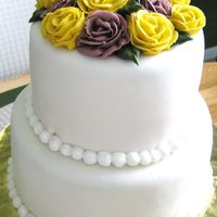 "2 Tier Fondant With Roses 2 tier cake 6"" and 8"" covered in MFF, piped beads w/buttercream w/buttercream roses on top."