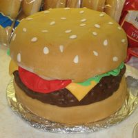 "Hamburger Cake Hamburger cake. 2-9"" cakes, 1-9"" dome cake, made w/marshmallow fondant."