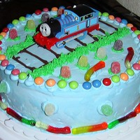 Thomas The Train Ice Cream Cake This was my first ice cream cake. The cake was marble with vanilla ice cream in the middle. My friend asked for candy on the cake... so...