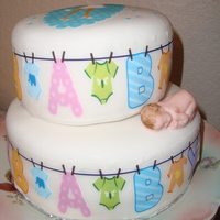 Baby Shower Cake Vanilla cake covered with fondant and decorated with edible images.