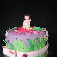"Thumbelina Fairy Garden  For a 3rd birthday, theme was fairies. The model is made to look like the birthday girl who has tight brown curls! 8"" 2 layer caramel..."
