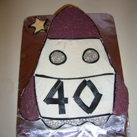 Rocket Ship My DH's 40th cake -God love him, he is a big kid at heart! He wanted a rocket ship cake! Again before my CC days - we all start...