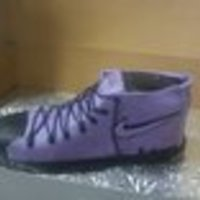Purple Shoe purple shoe cake for a woman obsessed with shoes. Chocolate cake with a chocolate liquer filling.