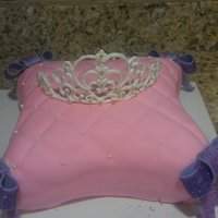 Princess This was a vanilla bean cake covered in fondant with fondant bows. 1st attempt at the royal icing tiara....and no damage!!!!!