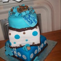 Baby Boy Blue Baby Shower Another cake with the infamous brown color in the theme. This time its blue and brown. She wanted a gift box cake topped with a baby on the...
