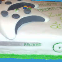 Xbox 360 This is an actual size xbox 360. The controllers are actual size as well. Made from fondant and gumpaste.