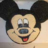 Mickey Mouse All buttercream icing. Made with 3 cake pans, face done by looking off picture.