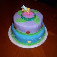 Tinker Bell Cake This is the first ca ke I have ever covered in Fondant.I have never used fondant before.I really enjoyed using MMF! This was made for my...