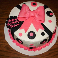 "Pink And Black Bow Birthday Cake   This is a 2 layer 9"" filled cake that I made for a coworker. Buttercream icing and fondant decorations."