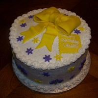"Yellow And Purple Birthday Cake With A Bow  I made this cake for a customer. It is a three layer, 9"" round, filled with cherry filling. The icing is buttercream and the..."