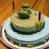 Froggy Baby Shower Cake Frosted in buttercream, fondant lily pad and other decorations, plastic frogs