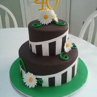 "Stripes And Daisies Stripes and daisies cake for a 40th birthday. 6"" and 10"" rounds covered in Satin Ice chocolate fondant. All decor is fondant...."