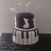 Stars And Piano  This is my second piano cake. it's a birthday cake for a 22nd year old. I think i'm getting better at the straight lines. next...