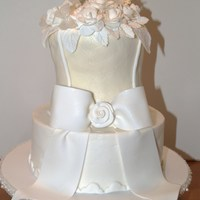 Bridal Tea Top tier covered with fondant, bottom tier covered with buttercream. Fondant roses and bow. Gelatine butterflies. Thanks for looking.