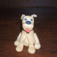 Fondant Puppy This was my first time doing a fondant figure.I really enjoyed doing it!!