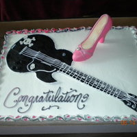 Rock N Roll Bridal Shower The sheet cake was done in buttercream, the guitar was done in a black fondant but the strings where done with frosting, and the shoe is...