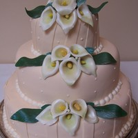 Calla Lily Wedding Ivory fondant cake with light off white dots, along with gumpaste calla lilies on it.